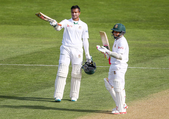 Bangladesh's Shakib Al Hasan celebrates his double century with teammate Mushfiqur Rahim during Day 2 of the first Test match against New Zealand at Basin Reserve in Wellington on Friday