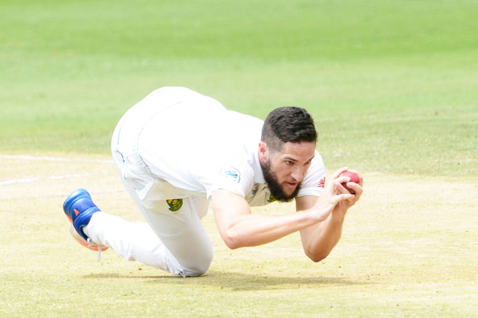 South Africa's Wayne Parnell dives forward to take a catch for the wicket of Sri Lanka's Nuwan Pradeep