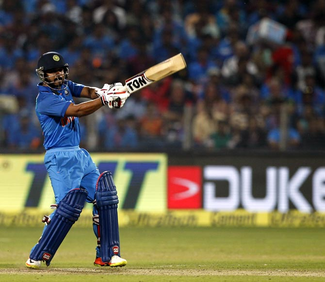 Kedar Jadhav hits out during the first ODI in Pune