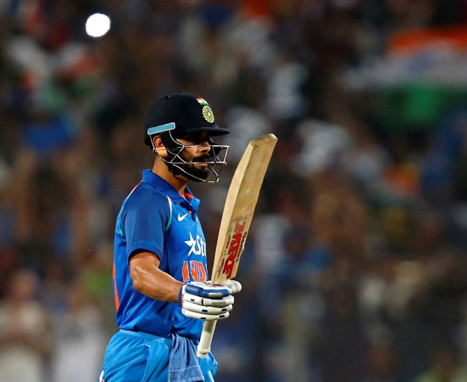 Virat Kohli celebrates his century during the first ODI in Pune on Sunday
