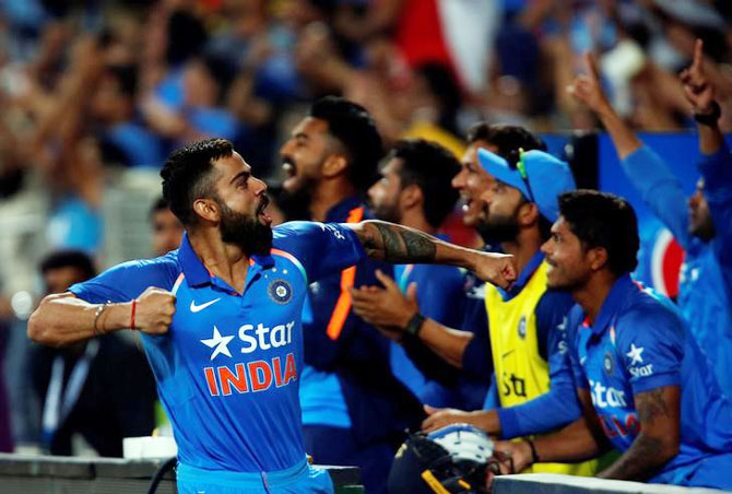 India's captain Virat Kohli celebrates after winning the first ODI against England at the Maharashtra Cricket Association Stadium in Pune on Sunday