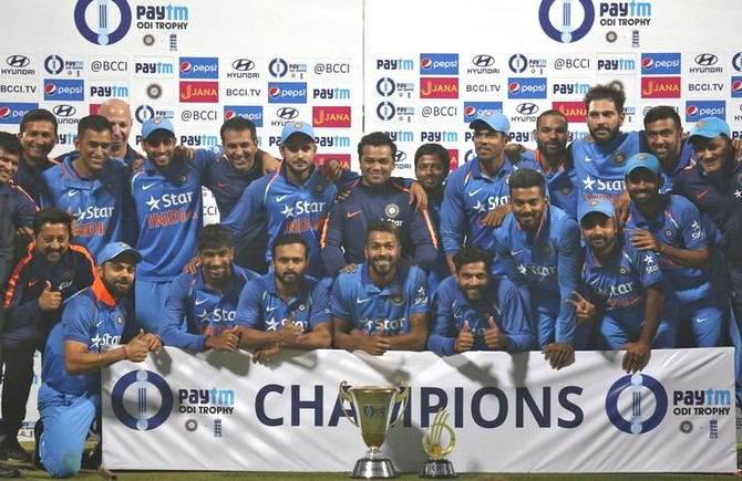 The Indian cricket team poses with the trophy on Sunday after claiming the 3-match series 2-1