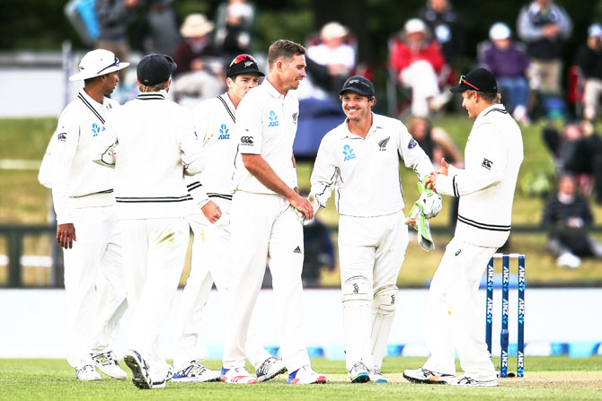 New Zealand's Tim Southee (centre) of is congratulated by teammates after taking five wickets on Day 1 of the second Test match against Bangladesh at Hagley Oval in Christchurch, New Zealand, on Friday
