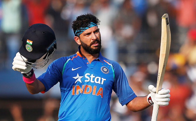 Yuvraj Singh celebrates on reaching his century against England during the 2nd ODI in Cuttack on Thursday