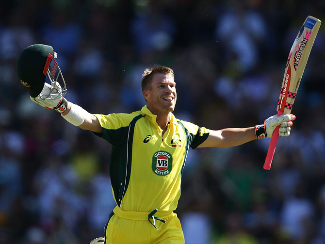 Australia's David Warner celebrates scoring a century against Pakistan during game four of the One Day International series at Sydney Cricket Ground on Sunday