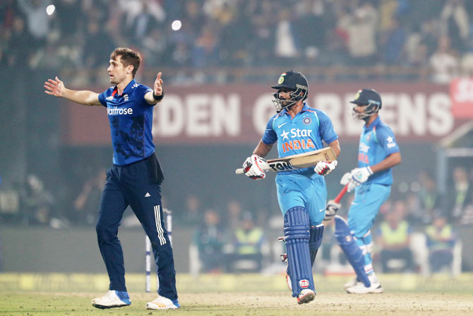 England's Chris Woakes celebrates the wicket of India's Kedar Jadhav during the third One Day International at Eden Gardens in Kolkata on Sunday