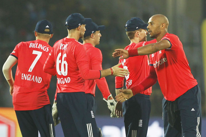 England's Tymal Mills celebrates the wicket of India's Hardik Pandya