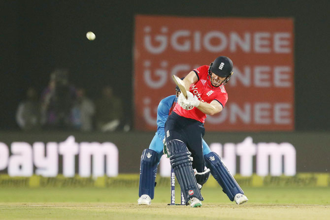 Eoin Morgan heaves the ball for a six