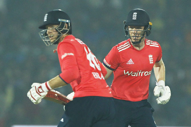 England captain Eoin Morgan and teammate Joe Root steal a run between wickets during the 1st T20 International against India at Green Park Stadium in Kanpur on Thursday