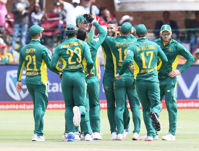 South Africa players congratulate teammate Wayne Parnell after he dismissed Sri Lanka's Niroshan Dickwella during the 1st One Day International at St Georges Park in Port Elizabeth, on Saturday