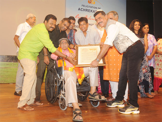 Former India and Mumbai cricketers Pravin Amre and Chandrakant Pandit among others felicitate coach par excellence Ramakant Archrekar at a function to mark 'Guru Purnima' on in Mumbai on Sunday