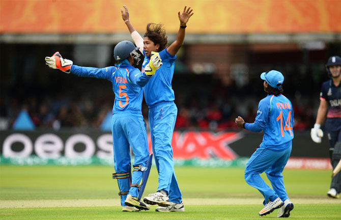 India's Jhulan Goswami and keeper Sushma Verma celebrate after picking an England wicket during their ICC Women's World Cup final at Lord's in London on Sunday
