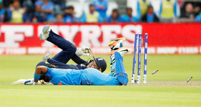 England's Sarah Taylor runs out India's Shikha Pandey