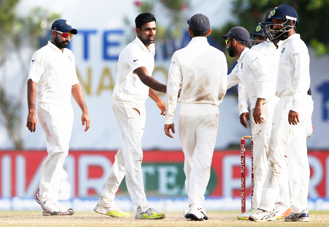 India's Ravichandran Ashwin celebrates with teammates after taking the wicket of Sri Lanka's Nuwan Pradeep on Saturday