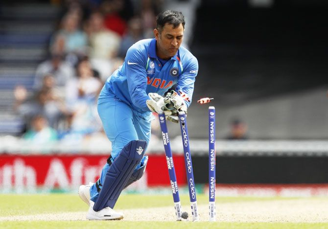 Mahendra Singh Dhoni runs out South Africa's Imran Tahir in a 2017 Champions Trophy game. Photograph: John Sibley Livepic/Action Images via Reuters