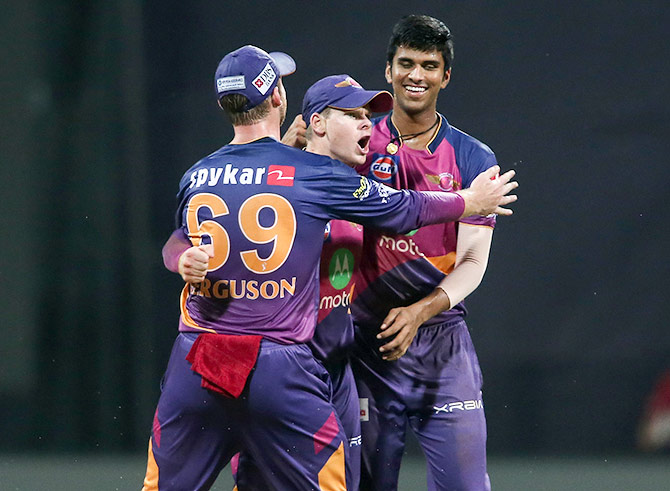 Lockie Ferguson and Rising Pune Supergiant Captain Steven Smith celebrate with Washington Sundar after the young spinner takes a wicket in an IPL 2017 game. Photograph: Shaun Roy/Sportzpics, IPL