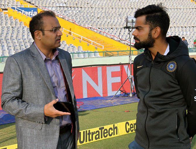 Virender Sehwag with India captain Virat Kohli