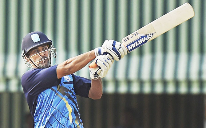 Jharkhand captain M S Dhoni in action during the Vijay Hazare Trophy against Jammu & Kashmir in Kalyani, West Bengal, on Monday