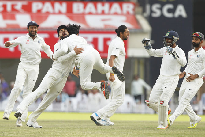 India captain Virat Kohli celebrates with Ravindra Jadeja after the latter dismissed Australia opener David Warner on Day 4 of the third Test at the JSCA International Stadium Complex in Ranchi on Sunday