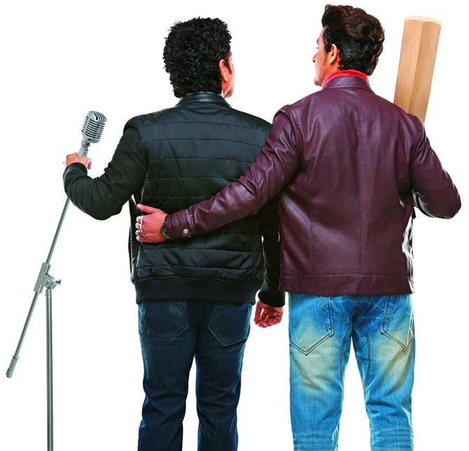 Is that Sachin Tendulkar holding a microphone?