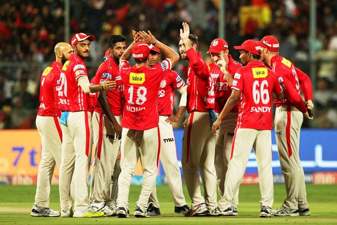 Punjab captain Glenn Maxwell celebrates a wicket with teammates during their IPL match in Bengaluru on Friday