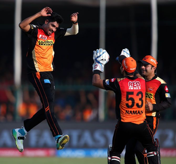 Mohammed Siraj, left, celebrates a wicket with his team mates