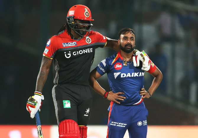 Chris Gayle pus his arms around Amit Mishra as he comforts him after his appeal was turned down by the umpire