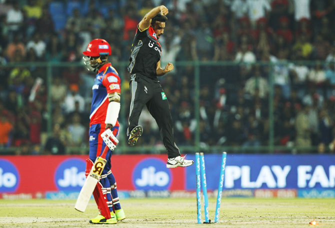 RCB's Harshal Patel celebrates after dismissing Delhi's Marlon Samuels