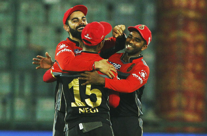 Royal Challengers Bangalore captain Virat Kohli celebrates after defeating Delhi Daredevils at the Feroz Shah Kotla Stadium in New Delhi on Sunday