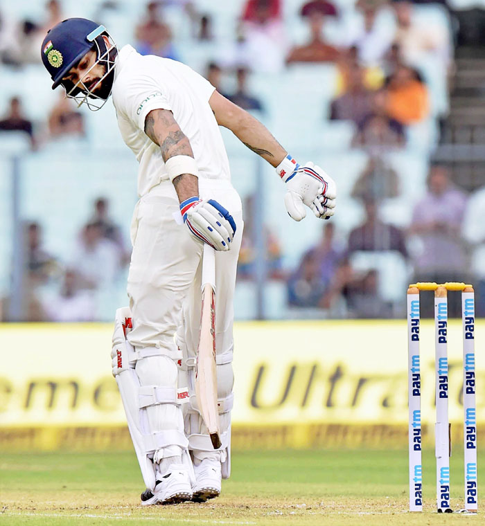 India cricket captain Virat Kohli reacts after his dismissal during the first day of the 1st cricket test match against Sri Lanka at Eden Gardens in Kolkata on Thursday