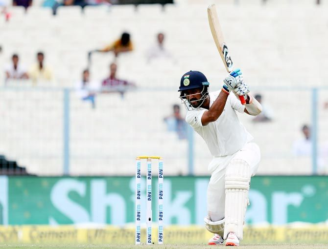 Cheteshwar Pujara scored a gutsy unbeaten 47 before rain stopped play on Day 2