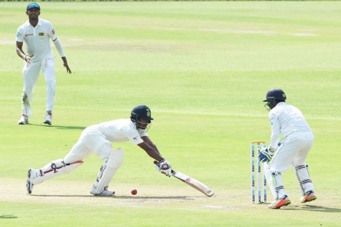 India's Wriddhiman Saha gets a reprieve as Sri Lanka wicket-keeper Niroshan Dickwella fails to stump the batsman