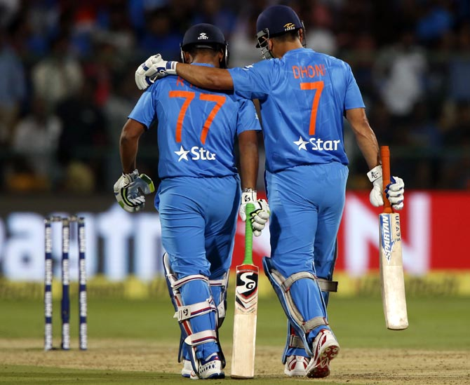 Rishabh Pant, left, with Mahendra Singh Dhoni