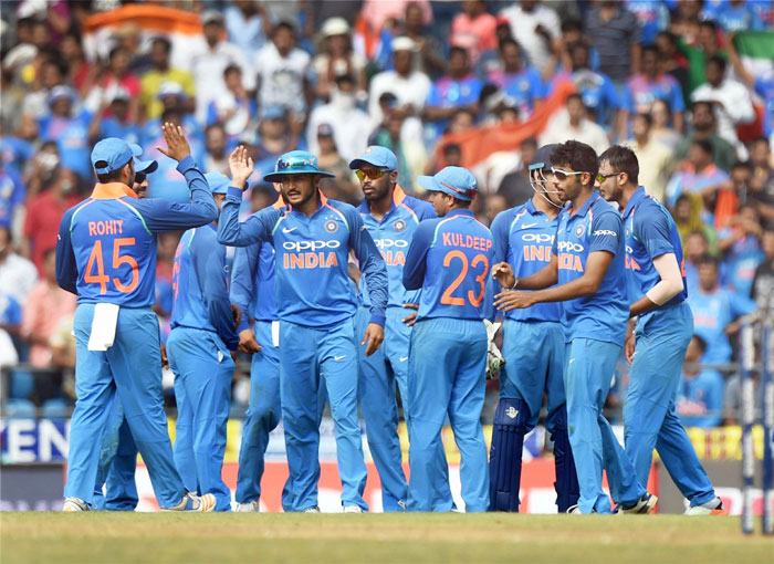 Indian bowler Axar Patel celebrates with teammates after dismissing Australia's David Warner at the Vidarbha Cricket Association Stadium, Jamtha, Nagpur on Sunday