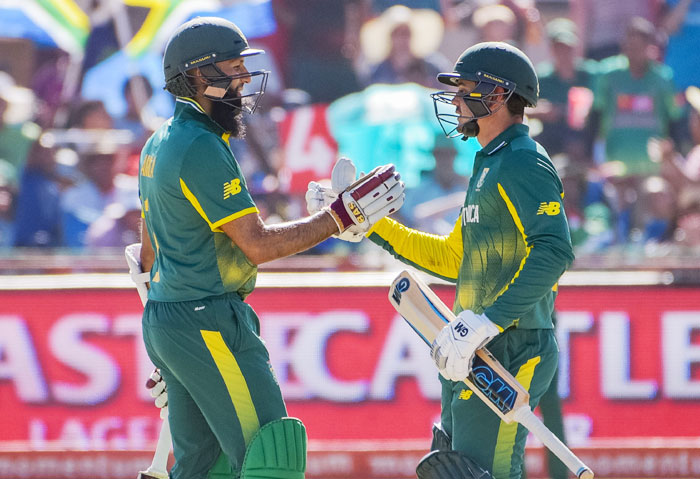 South Africa's Hashim Amla (left) congratulates teammate Quinton de Kock on his 50 runs during the 1st ODI against Bangladesh at Diamond Oval in Kimberley on Sunday