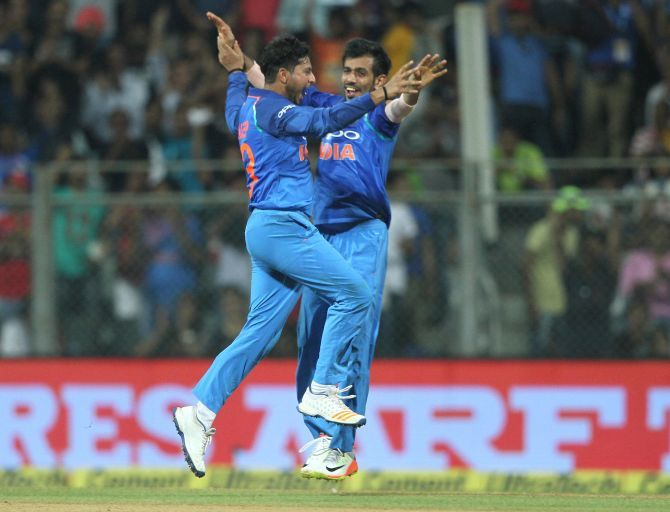 Kuldeep Yadav and Yuzvendra Chahal celebrate New Zealand skipper Kane Williamson's dismissal in the first ODI, in Mumbai, October 23, 2017. Photograph: BCCI