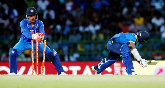 Sri Lanka's Akila Dananjaya is stumped out by India's MS Dhoni during the 5th ODI in Colombo on Sunday