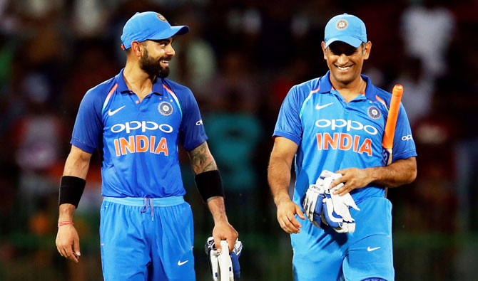 India's captain Virat Kohli and his teammate MS Dhoni celebrate after winning the match and the series against Sri Lanka