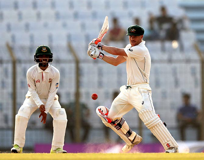 Gutsy Warner leads Australia's strong reply on Day 2