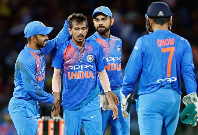 Yuzvendra Chahal celebrates a wicket with teammates. Kiwi coach Mike Hesson believes 'wrist spinners also provide scoring opportunities'