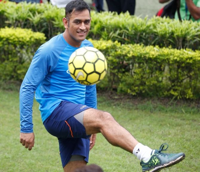 Dhoni plays football