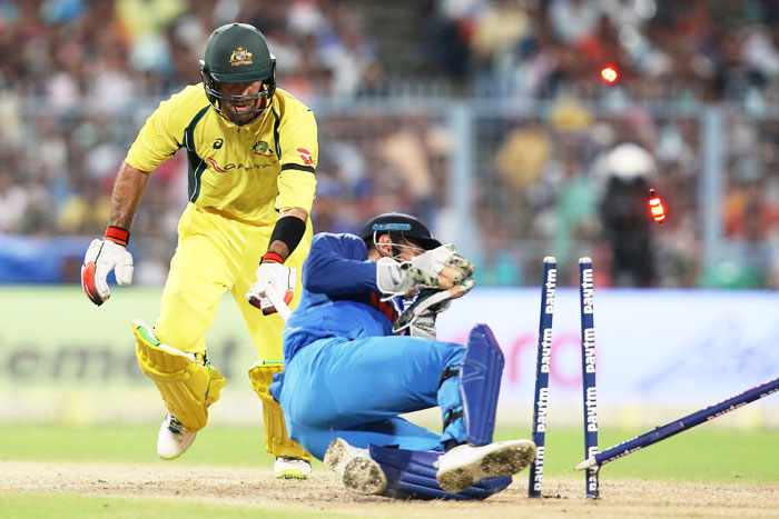 Mahendra Singh Dhoni removes the bails to have Glenn Maxwell run out