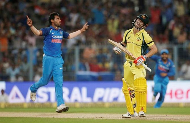 Bhuvneshwar Kumar celebrates the dismissal of David Warner