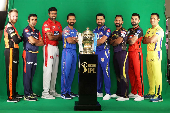 Captains of the IPL franchises pose with the IPL Trophy on Friday