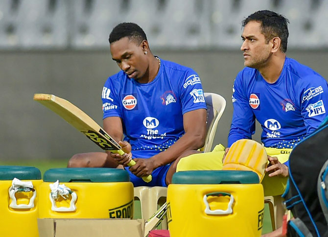 Chennai Super Kings' Dwayne Bravo and Mahendra Singh Dhoni during a practice session in Mumbai on Thursday