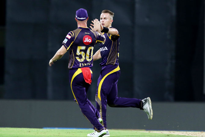 Kolkata Knight Riders' Tom Curran celebrates after taking the wicket of Chennai Superkings' Shane Watson