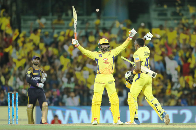 Ravindra Jadaja holds his arms aloft after striking the winning six