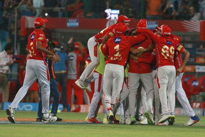 Kings XI Punjab players celebrate after defeating Delhi Daredevils on Monday