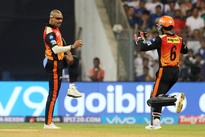 Sunrisers Hyderabad's Shikhar Dhawan celebrates the wicket of Mumbai Indians captain Rohit Sharma