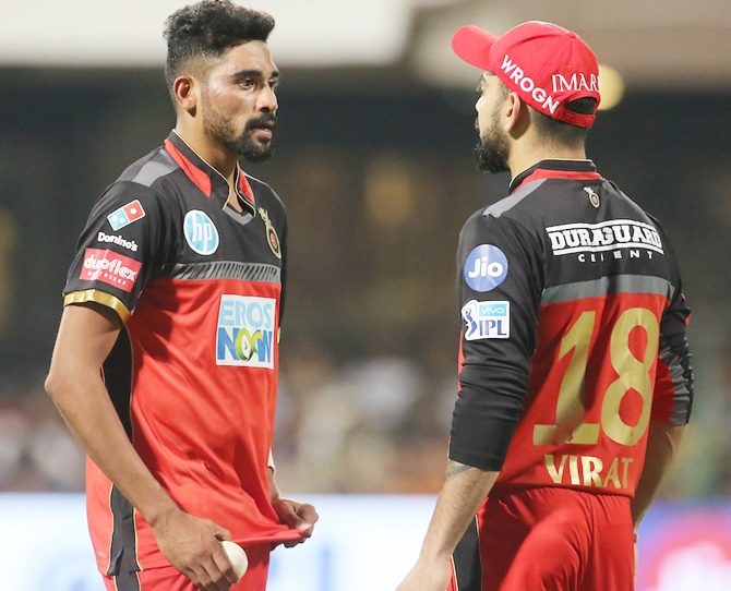 Virat Kohli has a chat with RCB pace bowler Mohammed Siraj. Chennai Super Kings chased down 206, and the RCB skipper lashed out at his bowlers' 'criminal' bowling, April 26, 2018. Photograph: BCCI
